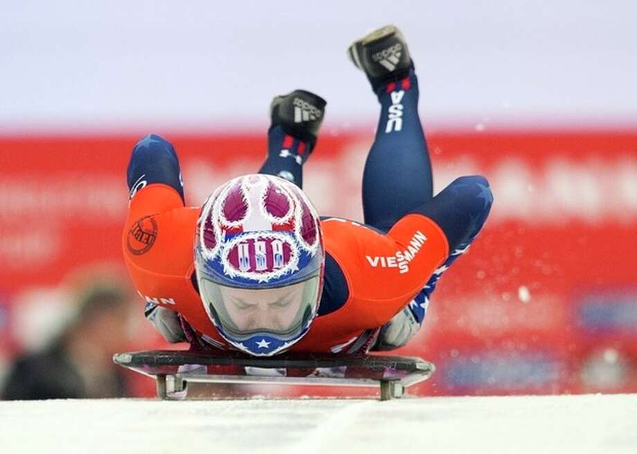 USA' Noelle Pikus-Pace heads down the course during women's World Cup skeleton competition in Calgary, Alberta, Friday, Nov. 29, 2013. (AP Photo/The Canadian Press, Larry MacDougal) / CP