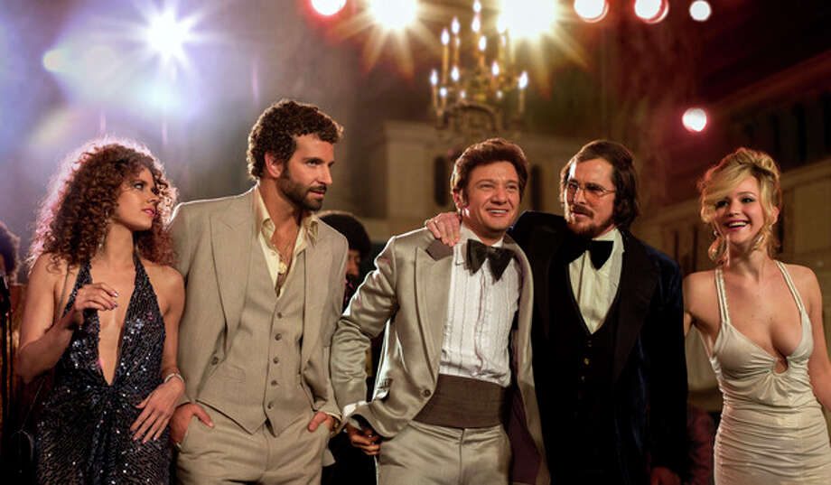 "This film image released by Sony Pictures shows, from left, Amy Adams, Bradley Cooper, Jeremy Renner, Christian Bale and Jennifer Lawrence in a scene from ""American Hustle."" While shooting in Boston, David O. Russell's upcoming fictionalization of the Abscam investigation, ""American Hustle,"" found itself caught up in the Boston Marathon bombing. When the city was essentially shut down for the manhunt, the production had to be stopped for a day. The experience, Russell says, was felt closely by the production. (AP Photo/Sony - Columbia Pictures, Francois Duhamel) / Sony - Columbia Pictures"