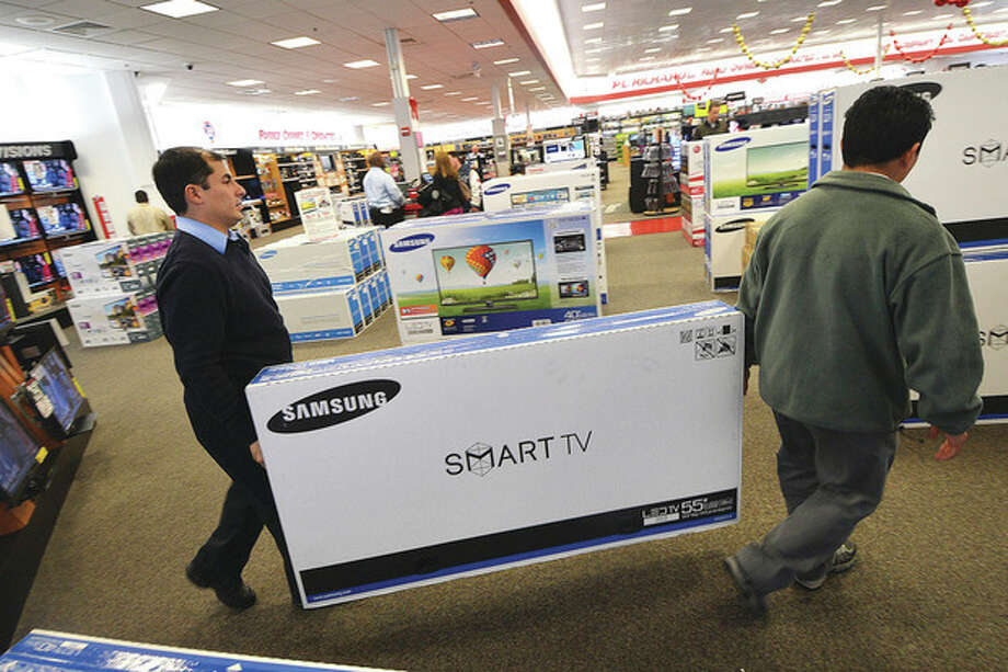 Hour Photo/Alex von KleydorffAnother television is sold during Black Friday sales at P.C. Richard & Son on Connecticut Ave.