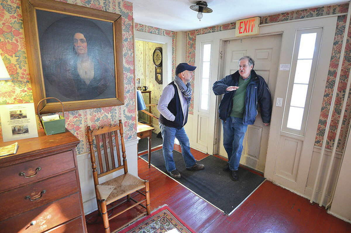 Hour Photo / Alex von Kleydorff . An oil portrait of a woman looks over the main room at The Silvermine Tavern as Owner Frank Whitman and Builder Developer Andrew Glazer talk about whats next for the century old property