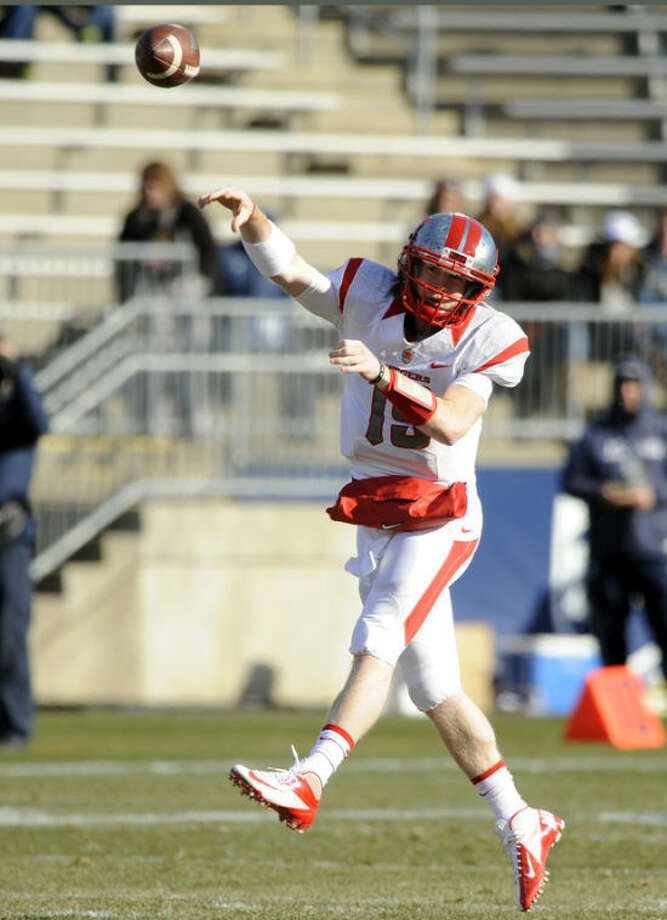 Rutgers quarterback Devin Ray (15) passes during the first half of an NCAA college football game against Connecticut, in East Hartford, Conn., on Saturday, Nov. 30, 2013. (AP Photo/Fred Beckham)