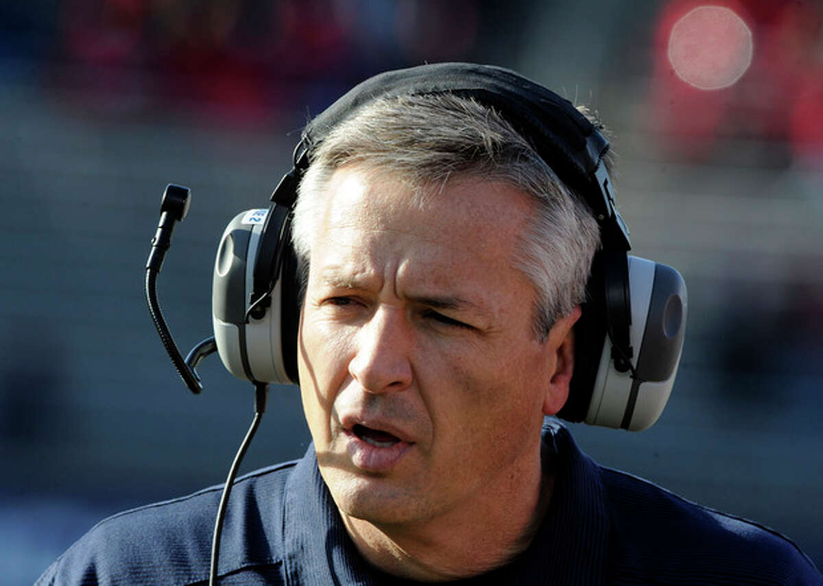 Connecticut head coach T.J. Weist reacts during the first half an NCAA college football game against Rutgers in East Hartford, Conn., on Saturday, Nov. 30, 2013. (AP Photo/Fred Beckham)