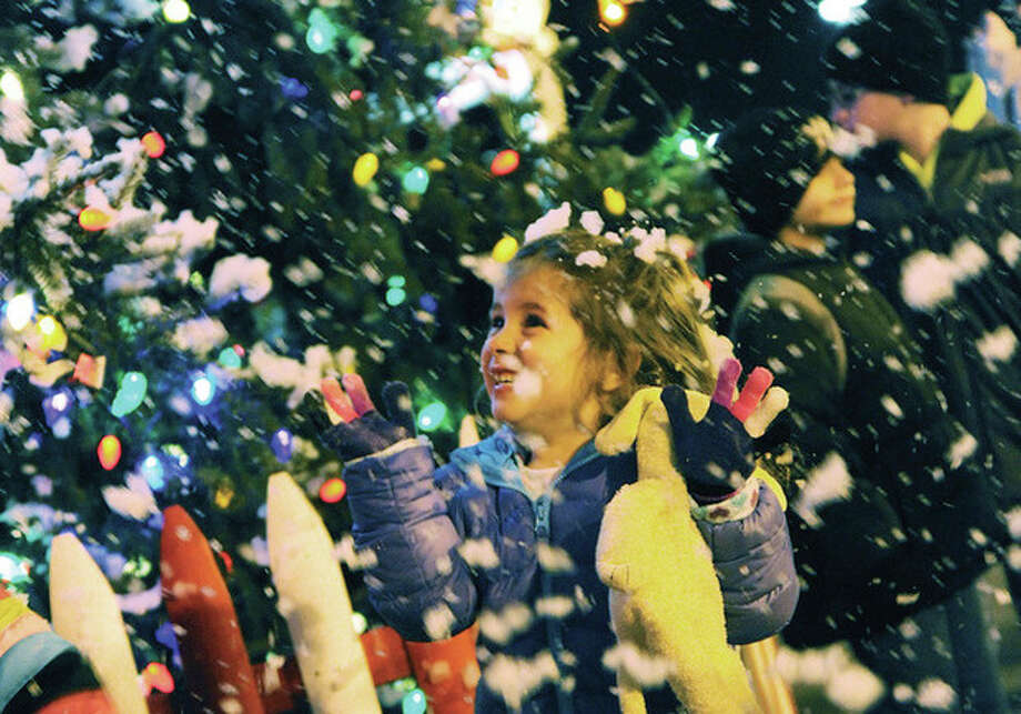 Luciana DiDodo 4, enjoys the Stew Leonards annual Christmas Tree lighting and the snow machine Tuesday night. Hour photo/Matthew Vinci