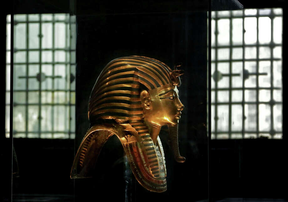 In this Wednesday, Oct. 30, 2013 photo, the solid gold mask of King Tutankhamun is seen in its glass case, in the Egyptian Museum near Tahrir Square in Cairo, Egypt. The 111-year-old museum, a treasure trove of pharaonic antiquities, has long been one of the centerpieces of tourism to Egypt. But the constant instability since the 2011 uprising that toppled autocrat Hosni Mubarak has dried up tourism to the country, slashing a key source of revenue. Moreover, political backbiting and attempts to stop corruption have had a knock-on effect of bringing a de facto ban on sending antiquities on tours to museums abroad, cutting off what was once a major source of funding for the museum. (AP Photo/Nariman El-Mofty) / AP
