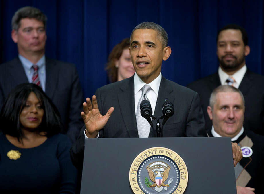 "President Barack Obama gestures as he speaks about the new health care law, Tuesday, Dec. 3, 2013, in the South Court Auditorium in the Eisenhower Executive Office Building on the White House complex in Washington. The president said his signature health care law ""is working and will work into the future."" Obama said the benefits of the law have ""gotten lost"" in recent months as attention focused on the widespread problems that crippled the website where people can sign up for health insurance. On stage with the president are Americans the White House says have gained as a result of the Affordable Care Act. (AP Photo/Carolyn Kaster) / AP"