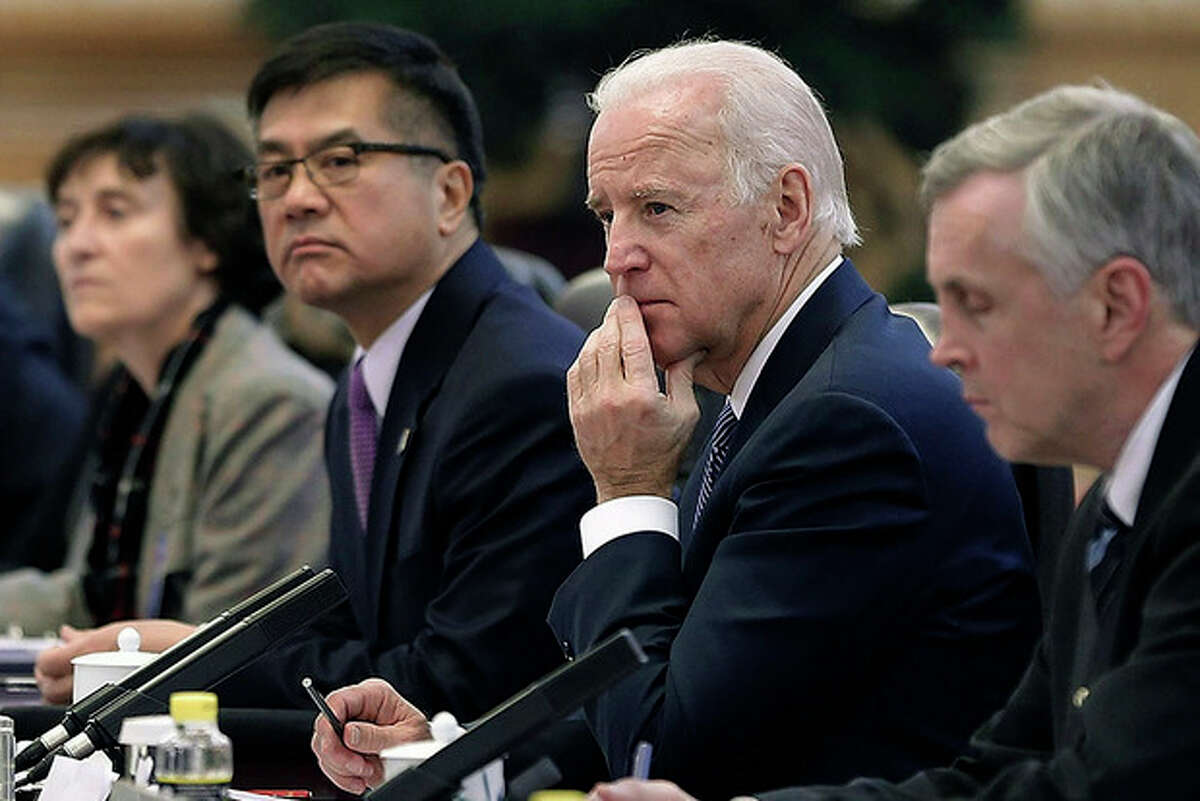 AP Photo / Lintao Zhang, Pool Vice President Joe Biden, center, listens during his meeting with Chinese President Xi Jinping inside the Great Hall of the People Wednesday. Biden and Xi discussed efforts to forge a new model for relations between the major powers, but they've made no public comments about a new Chinese air defense zone that's become a major friction point in Asia.