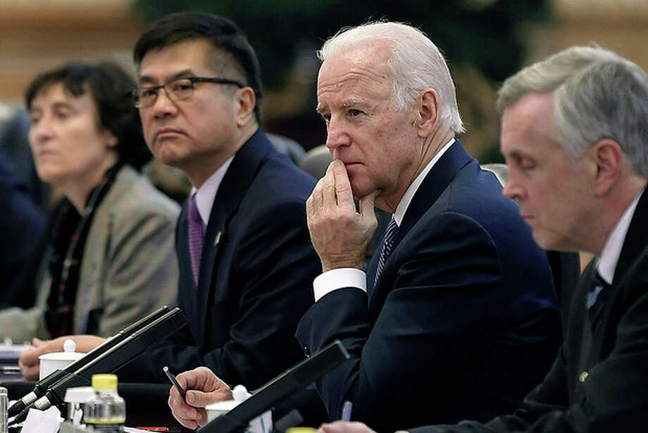 AP Photo / Lintao Zhang, PoolVice President Joe Biden, center, listens during his meeting with Chinese President Xi Jinping inside the Great Hall of the People Wednesday. Biden and Xi discussed efforts to forge a new model for relations between the major powers, but they've made no public comments about a new Chinese air defense zone that's become a major friction point in Asia. / Getty Images Pool