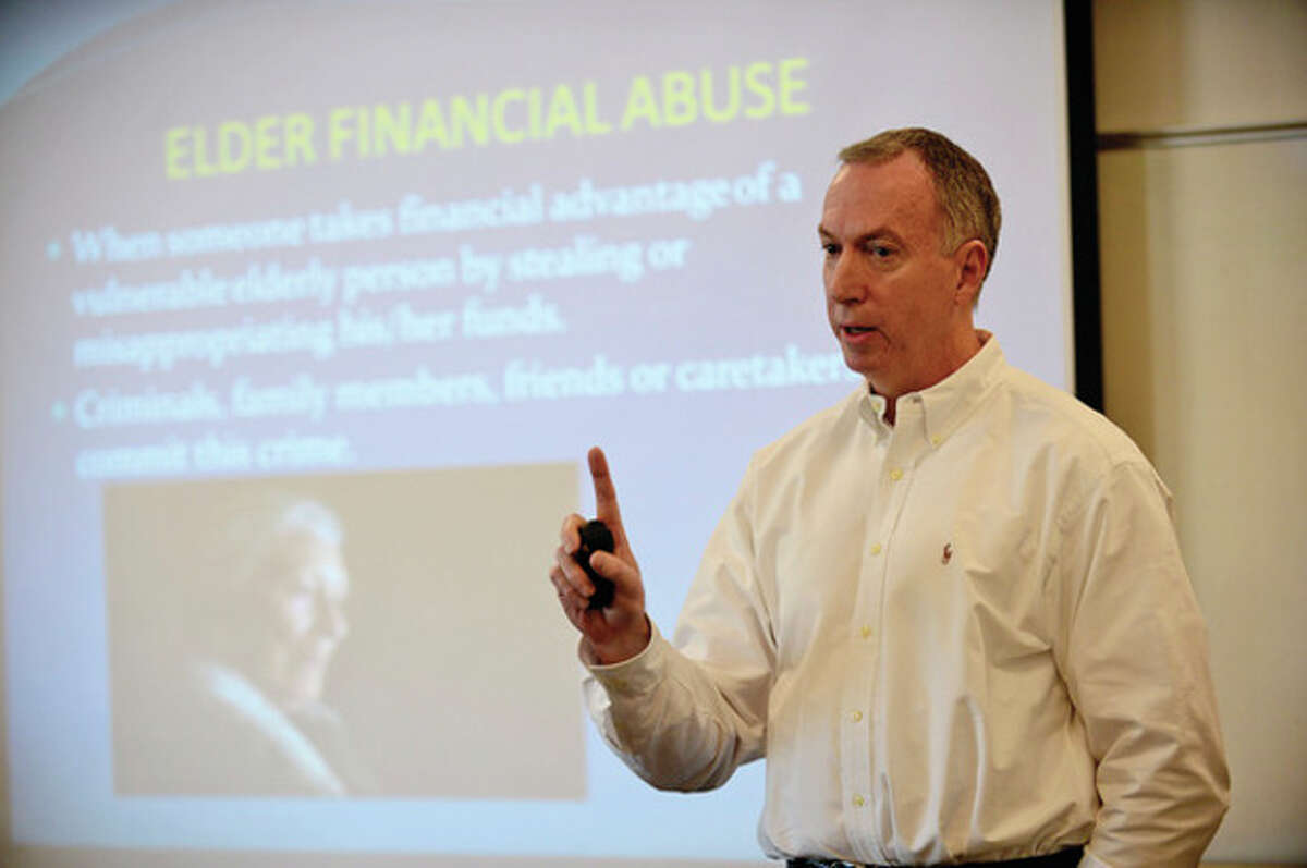 Hour photo / Erik Trautmann Don McGran, Security Advisor at Fairfield County Bank, discusses the many current scams that are being employed against elderly citizens in our area during a program at the Wilton Library Wednesday morning that was co-sponsored by Fairfield County Bank and the library.