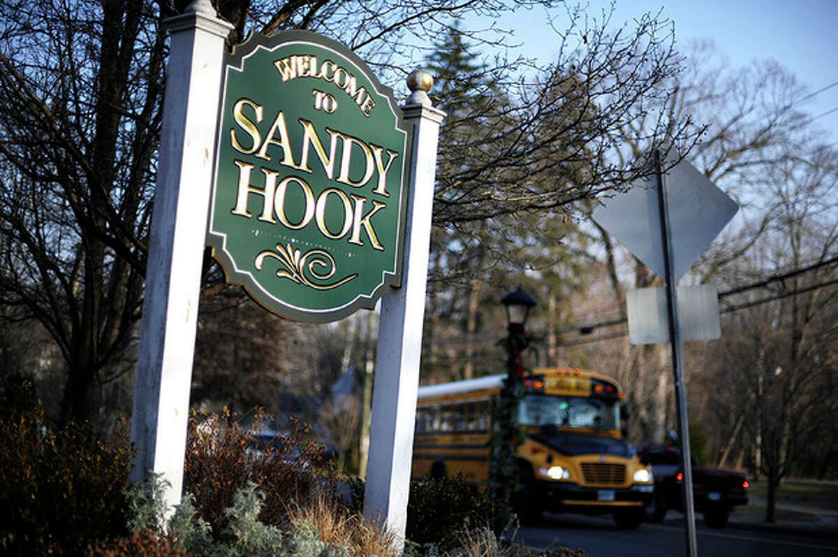 AP Photo / Jessica Hill A bus drives past a sign reading Welcome to Sandy Hook Wednesday. The 911 calls from the Sandy Hook Elementary School shootings released show town dispatchers urged panicked callers to take cover, mobilized help and asked about the welfare of the children as the boom of gunfire could be heard at times in the background. The recordings are released under court order after a legal challenge from The Associated Press.