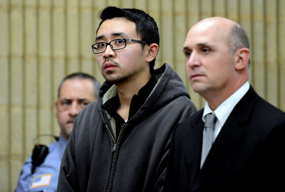 University of New Haven student William Dong, 22, of Fairfield, Conn., with assistant public defender Kevin Williams, right, appears during his arraingment Wednesday, Dec. 4, 2013, at Superior Court in Milford, Conn. Dong, 22, was charged with illegal possession of an assault weapon and other crimes after Tuesday's scare, which led to a a University of New Haven campus lockdown of more than four hours. Police say they don't know why Dong brought guns to the campus. (AP Photo/The Connecticut Post, Autumn Driscoll, Pool) / POOL, The Connecticut Post
