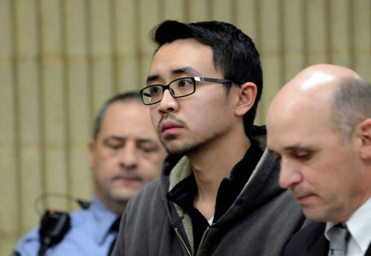 University of New Haven student William Dong, 22, of Fairfield, Conn., with assistant public defender Kevin Williams, right, appears during his arraingment Wednesday, Dec. 4, 2013, at Superior Court in Milford, Conn. Dong, 22, was charged with illegal possession of an assault weapon and other crimes after Tuesday's scare, which led to a a University of New Haven campus lockdown of more than four hours. Police say they don't know why Dong brought guns to the campus. (AP Photo/The Connecticut Post, Autumn Driscoll, Pool)
