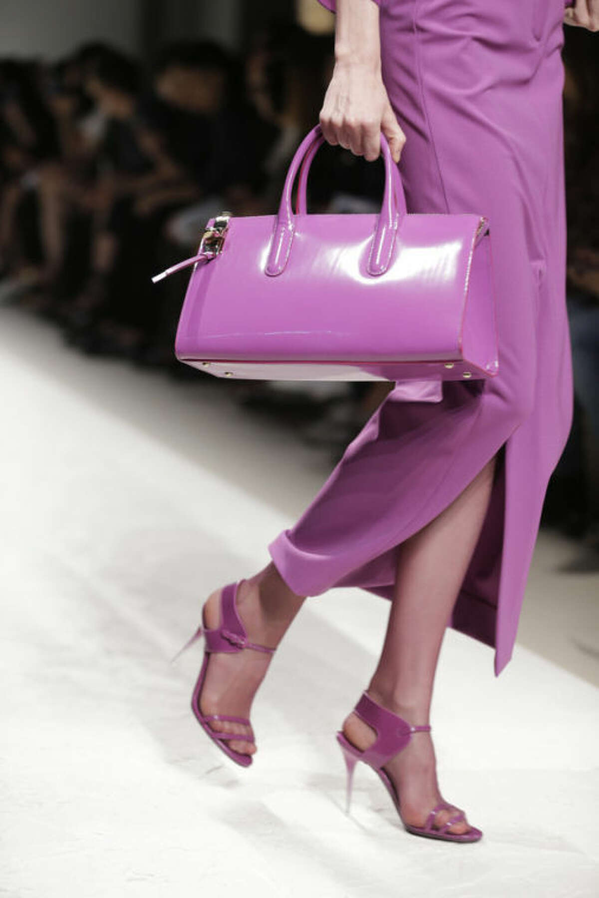 FILE - In this Sept. 19, 2013 file photo, a model wears a creation for Max Mara women's Spring-Summer 2014 collection, part of the Milan Fashion Week, unveiled in Milan, Italy. Orchid is growing on us: A version of the purple hue is Pantone Inc.?'s color of the year for 2014. AP Photo/Luca Bruno)