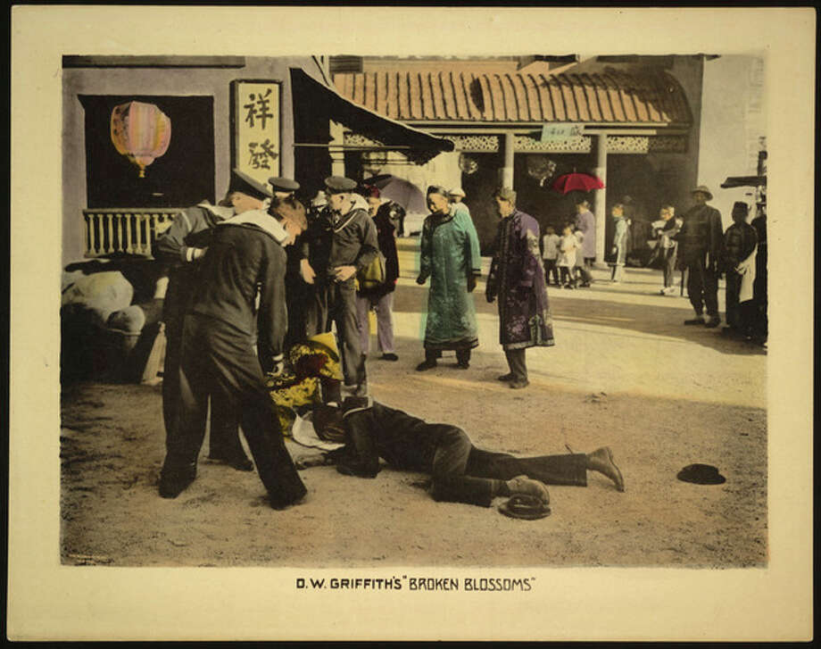 "This undated handout image provided by the Library of Congress shows a motion picture lobby card for D.W. Griffith's ""Broken Blossoms"" (1919), showing sailors standing over two bodies, lying on the dirt street in Chinatown. The Library of Congress has conducted the first comprehensive survey of American feature-length silent films and found 70 percent of them have been lost. Of the nearly 11,000 silent feature films made in America between 1912 and 1930, the survey found only 14 percent still exist in their original format. About 11 percent of the films that survive only exist as foreign versions or on lower-quality formats. (AP Photo/Library of Congess) / Library of Congress"