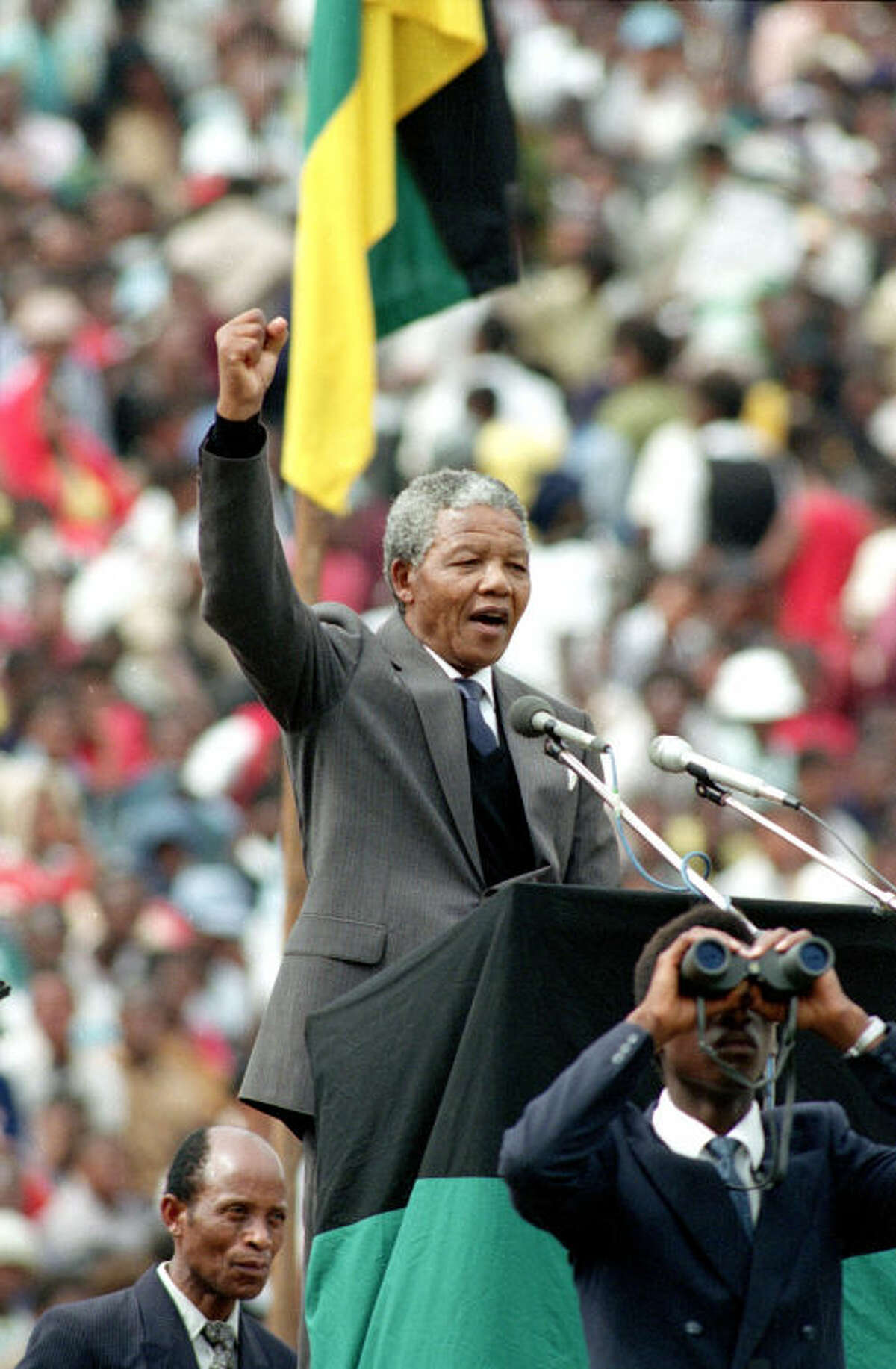 FILE - In this Feb. 13, 1990, file photo, African National Congress leader Nelson Mandela gives the black power salute to 120,000 ANC supporters packing Soccer City stadium in the Soweto township of Johannesburg, South Africa, shortly after his release from 27 years in prison. South Africa's president says, Thursday, Dec. 5, 2013, that Mandela has died. He was 95. (AP Photo, File)
