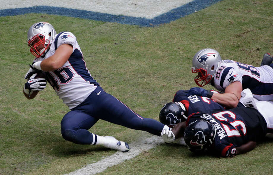 New England Patriots' James Develin (46) scores a touchdown against the Houston Texans during the third quarter of an NFL football game on Sunday, Dec. 1, 2013, in Houston. (AP Photo/David J. Phillip) / AP