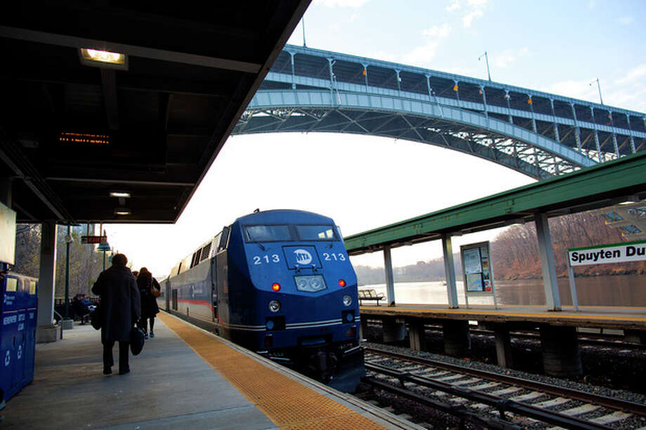 A Metro-North passenger train that is pushed by a locomotive rolls through the Spuyten Duyvil station in the Bronx borough of New York Wednesday, Dec. 4, 2013, not far from the area where a fatal derailment disrupted service on the Hudson Line of the railroad Sunday, Dec. 1. The line was running at ninety eight percent capacity today, according to Metro-North. (AP Photo/Craig Ruttle) / FR61802 AP