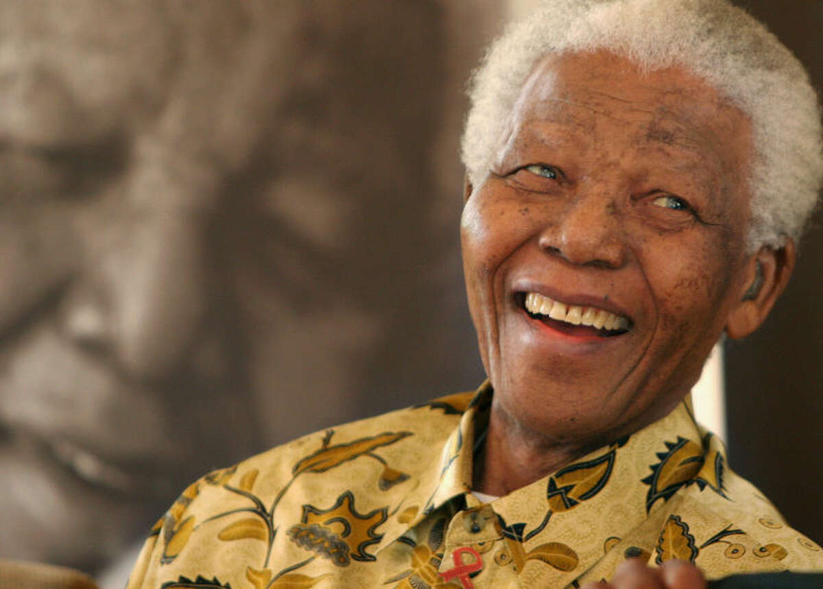 FILE - In this Dec. 7, 2005, file photo, former South African President Nelson Mandela, 87, is in a jovial mood at the Mandela Foundation in Johannesburg, where he met with the winner and runner-up of the local