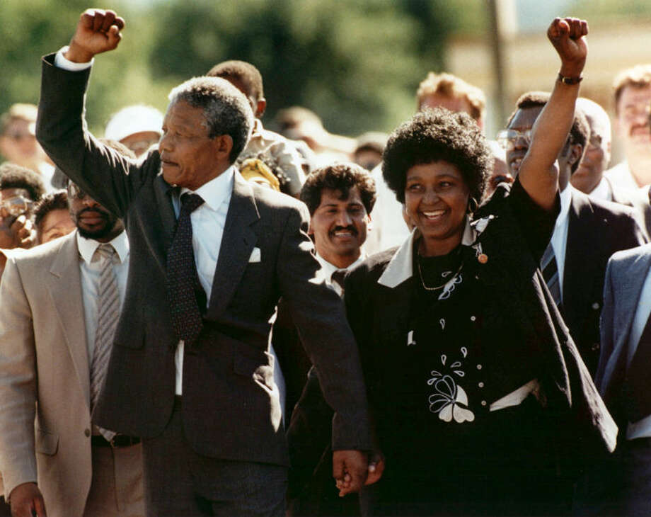 FILE - In this Feb. 11, 1990, file photo, Nelson Mandela and his wife, Winnie, raise clenched fists as they walk hand-in-hand upon his release from prison in Cape Town, South Africa. South Africa's president says, Thursday, Dec. 5, 2013, that Mandela has died. He was 95. (AP Photo/Greg English, File)