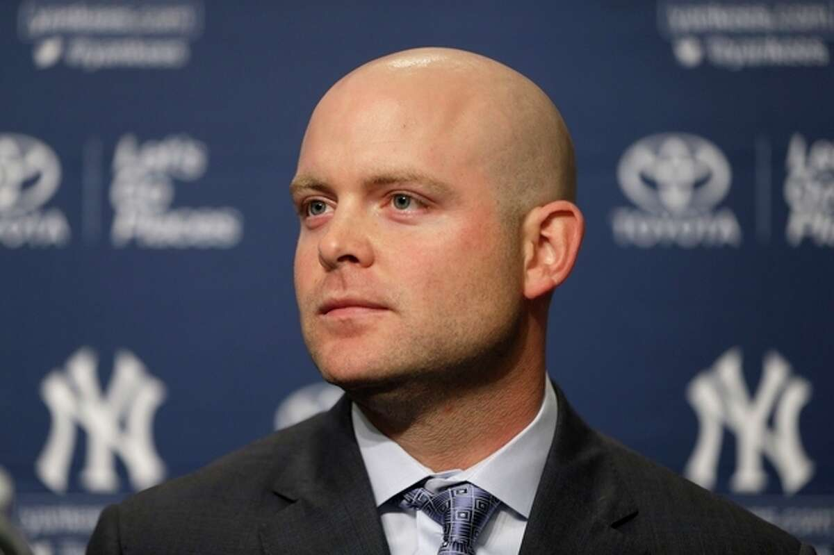 New York Yankees' Brian McCann attends a baseball news conference at Yankee Stadium in New York, Thursday, Dec. 5, 2013. McCann, an all-Star catcher, completed his $85 million, five-year contract with the team on Tuesday, in what the team called a