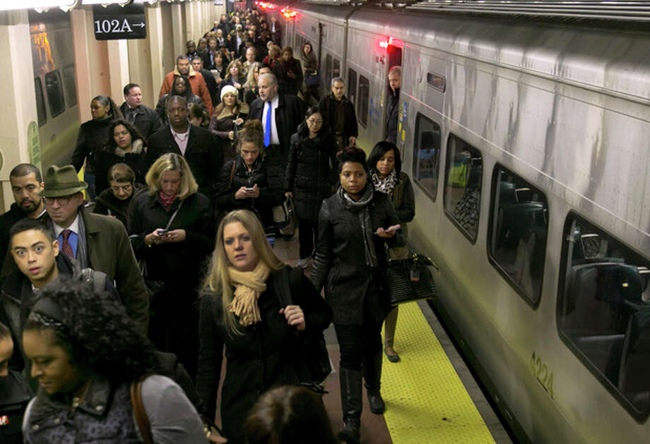 Passengers exit a Hudson Line Metro-North train at New York's Grand Central Terminal as service resumed, Wednesday, Dec. 4, 2013. Service on Metro-North's Hudson Line had been shut down after a fatal New York City derailment on Sunday, Dec. 1. Officials expect 98 percent of service to be restored to the affected line Wednesday, New York Gov. Andrew Cuomo said. (AP Photo/Richard Drew) / AP