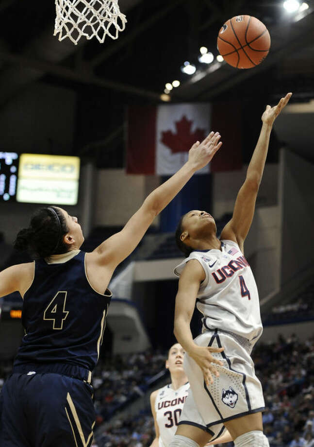 Connecticut's Moriah Jefferson, right, shoots over UC Davis' Idit Oryon, left, during the first half of an NCAA college basketball game, Thursday, Dec. 5, 2013, in Hartford, Conn. (AP Photo/Jessica Hill)
