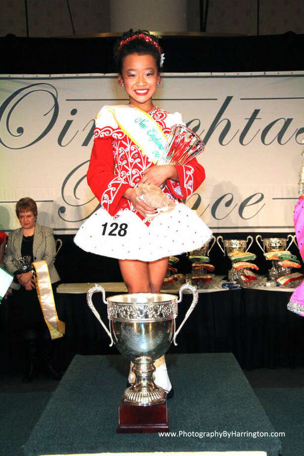 Chloe Armstrong is shown with the trophy she won at the competition.