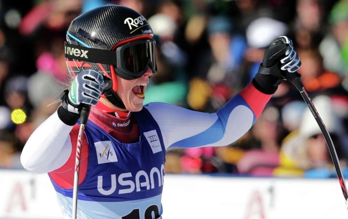 Switzerland's Lara Gut raises her arms and celebrates at the finish line following her run in the women's World Cup super-G skiing event, in Beaver Creek, Colo., Saturday, Nov. 30, 2013. (AP Photo/Charles Krupa)