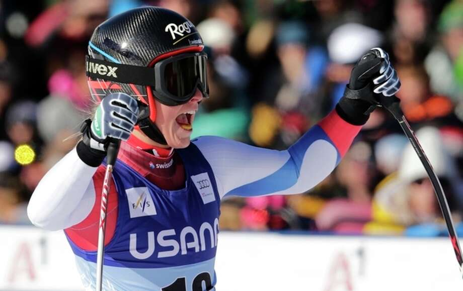 Switzerland's Lara Gut raises her arms and celebrates at the finish line following her run in the women's World Cup super-G skiing event, in Beaver Creek, Colo., Saturday, Nov. 30, 2013. (AP Photo/Charles Krupa) / AP