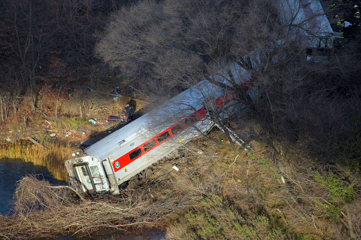 First responders gather around the derailment of a Metro North passenger train in the Bronx borough of New York Dec. 1, 2013 The Fire Department of New York says there are