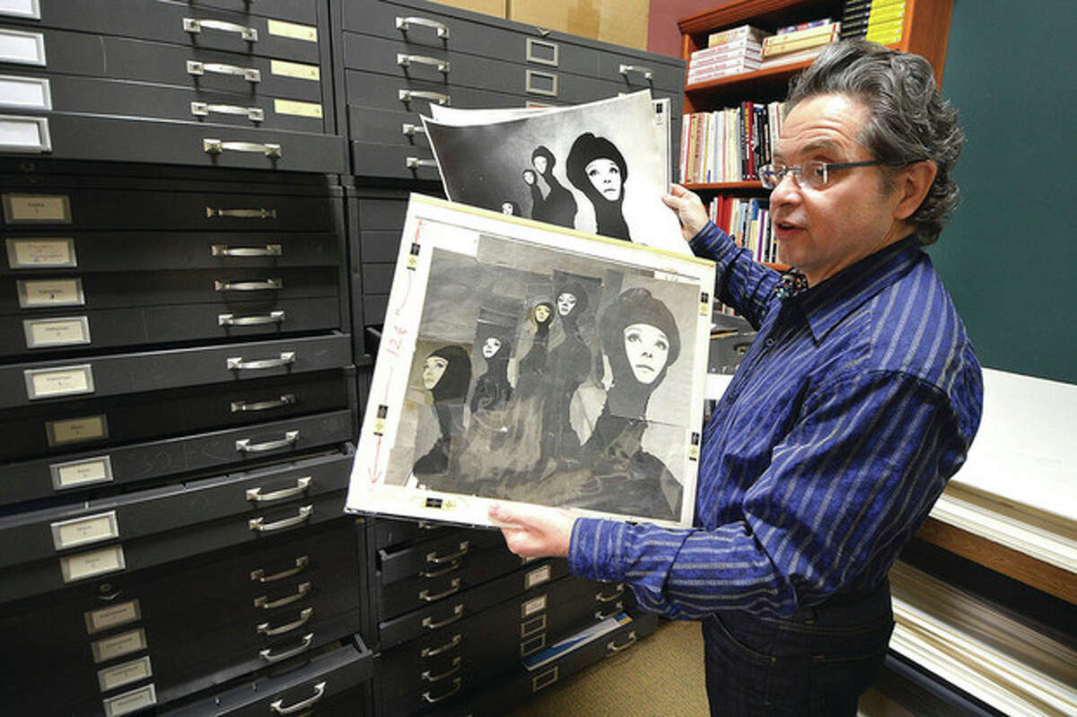 Hour Photo / Alex von Kleydorff Artist's Market owner Jeffrey Price looks over a Richard Avedon photograph of Audrey Hepburn pulled from a file cabinet full of vintage photos from the Archives of the defunct Famous Photographers School in Westport.