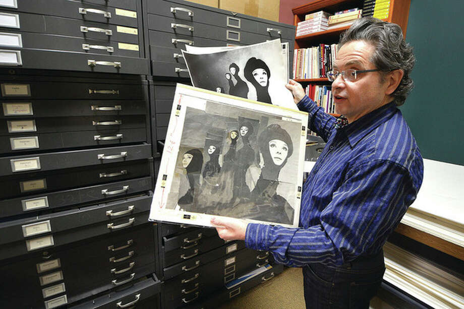 Hour Photo / Alex von KleydorffArtist's Market owner Jeffrey Price looks over a Richard Avedon photograph of Audrey Hepburn pulled from a file cabinet full of vintage photos from the Archives of the defunct Famous Photographers School in Westport.
