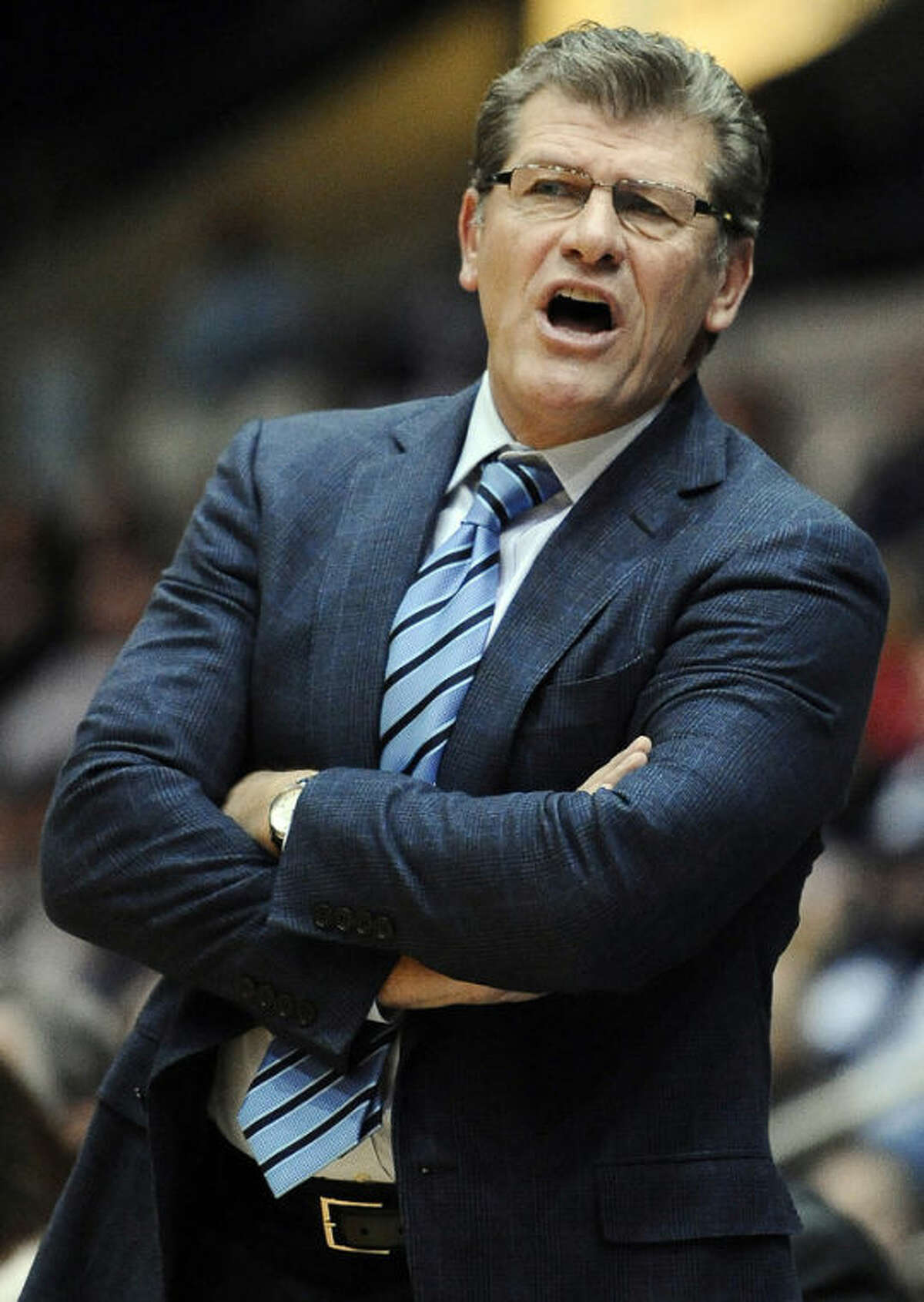 Connecticut head coach Geno Auriemma stands during the second half of an NCAA college basketball game against Ohio State, Sunday, Dec. 1, 2013, in Springfield, Mass. Connecticut won 70-49. (AP Photo/Jessica Hill)