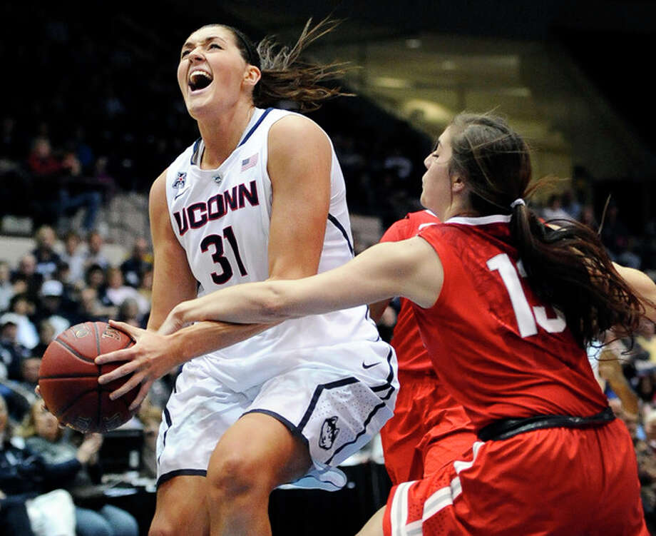 Ohio State's Cait Craft, right, fouls Connecticut's Stefanie Dolson, left, during the second half of an NCAA college basketball game Sunday, Dec. 1, 2013, in Springfield, Mass. Connecticut won 70-49. (AP Photo/Jessica Hill) / FR125654 AP