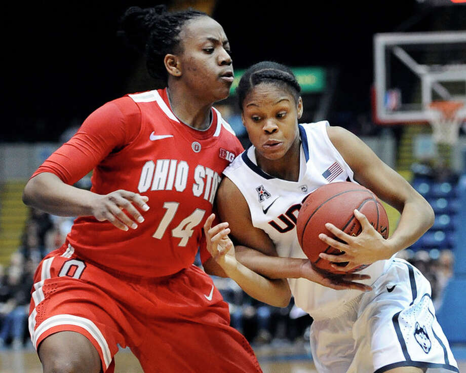 Connecticut's Moriah Jefferson, right, drives to the basket while guarded by Ohio State's Ameryst Alston, left, during the second half of an NCAA college basketball game Sunday, Dec. 1, 2013, in Springfield, Mass. Connecticut won 70-49. (AP Photo/Jessica Hill) / FR125654 AP