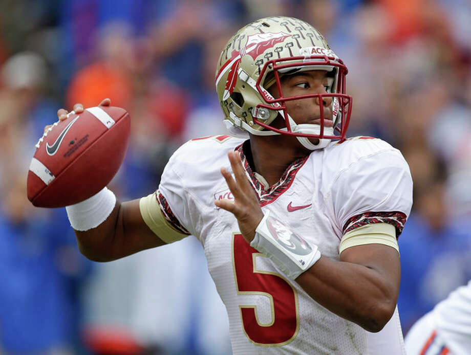 Florida State quarterback Jameis Winston looks for a receiver during the first half of an NCAA college football game against Florida in Gainesville, Fla., Saturday, Nov. 30, 2013.(AP Photo/John Raoux) / AP