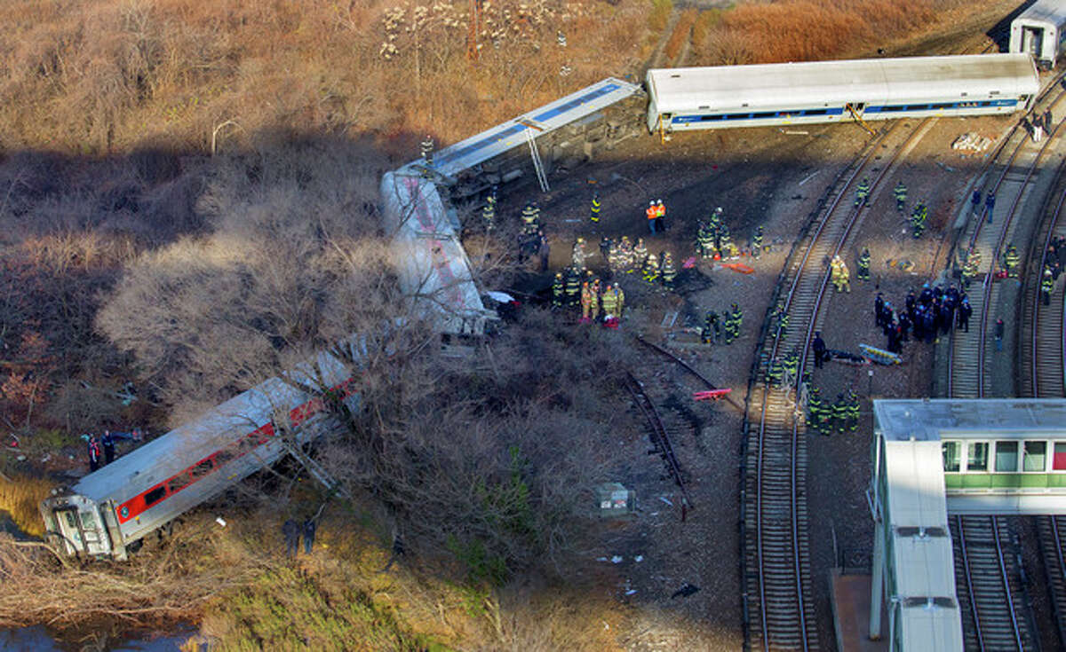 First responders gather at the derailment of a Metro North passenger train in the Bronx borough of New York Sunday, Dec. 1, 2013 The Fire Department of New York says there are