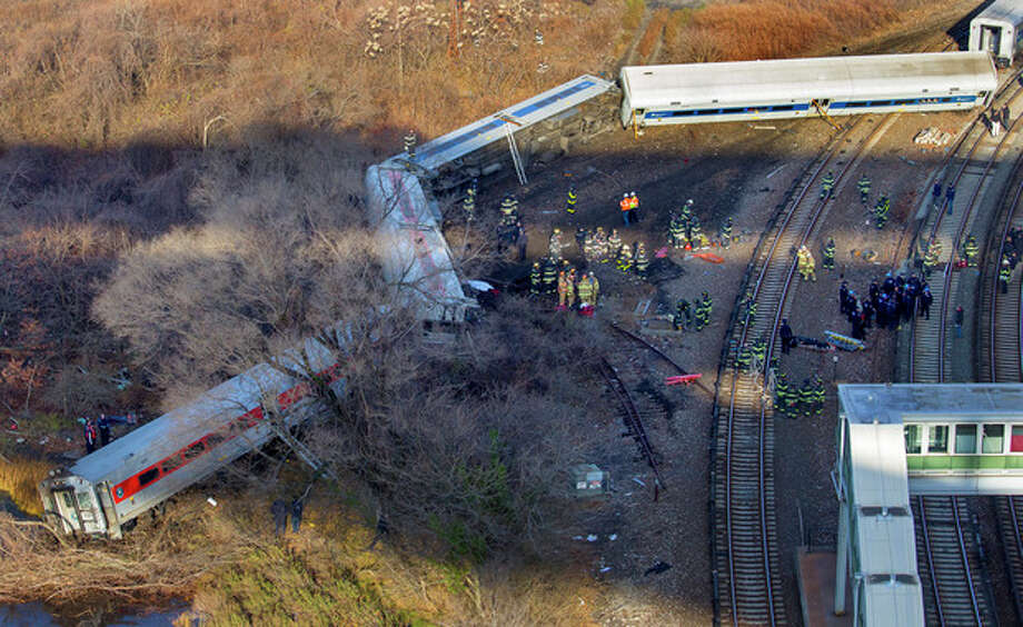 "First responders gather at the derailment of a Metro North passenger train in the Bronx borough of New York Sunday, Dec. 1, 2013 The Fire Department of New York says there are ""multiple injuries"" in the train derailment, and 130 firefighters are on the scene. Metropolitan Transportation Authority police say the train derailed near the Spuyten Duyvil station. (AP Photo/Craig Ruttle) / FR61802 AP"