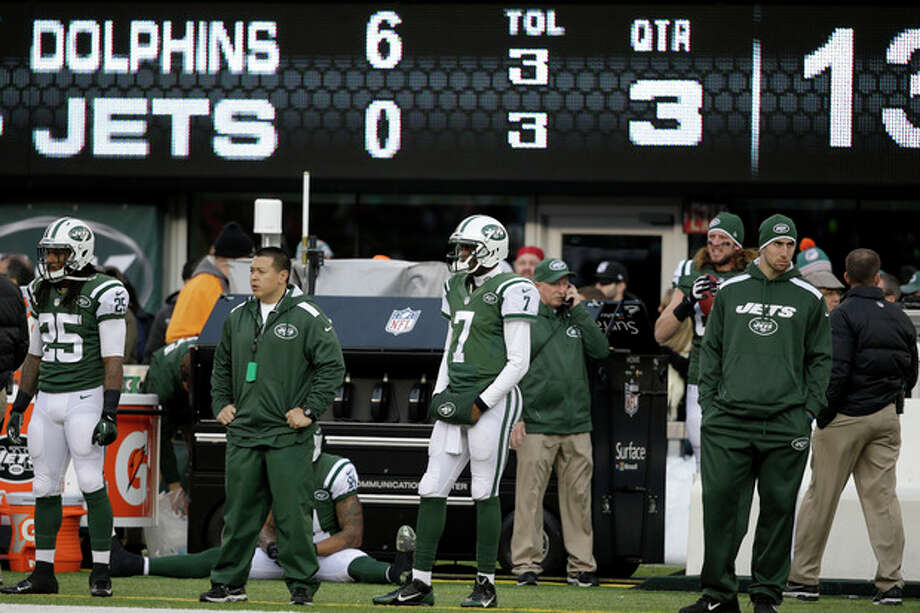 New York Jets quarterback Geno Smith (7) looks on from the sideline after being pulled during the second half of an NFL football game against the Miami Dolphins, Sunday, Dec. 1, 2013, in East Rutherford, N.J. (AP Photo/Seth Wenig) / AP