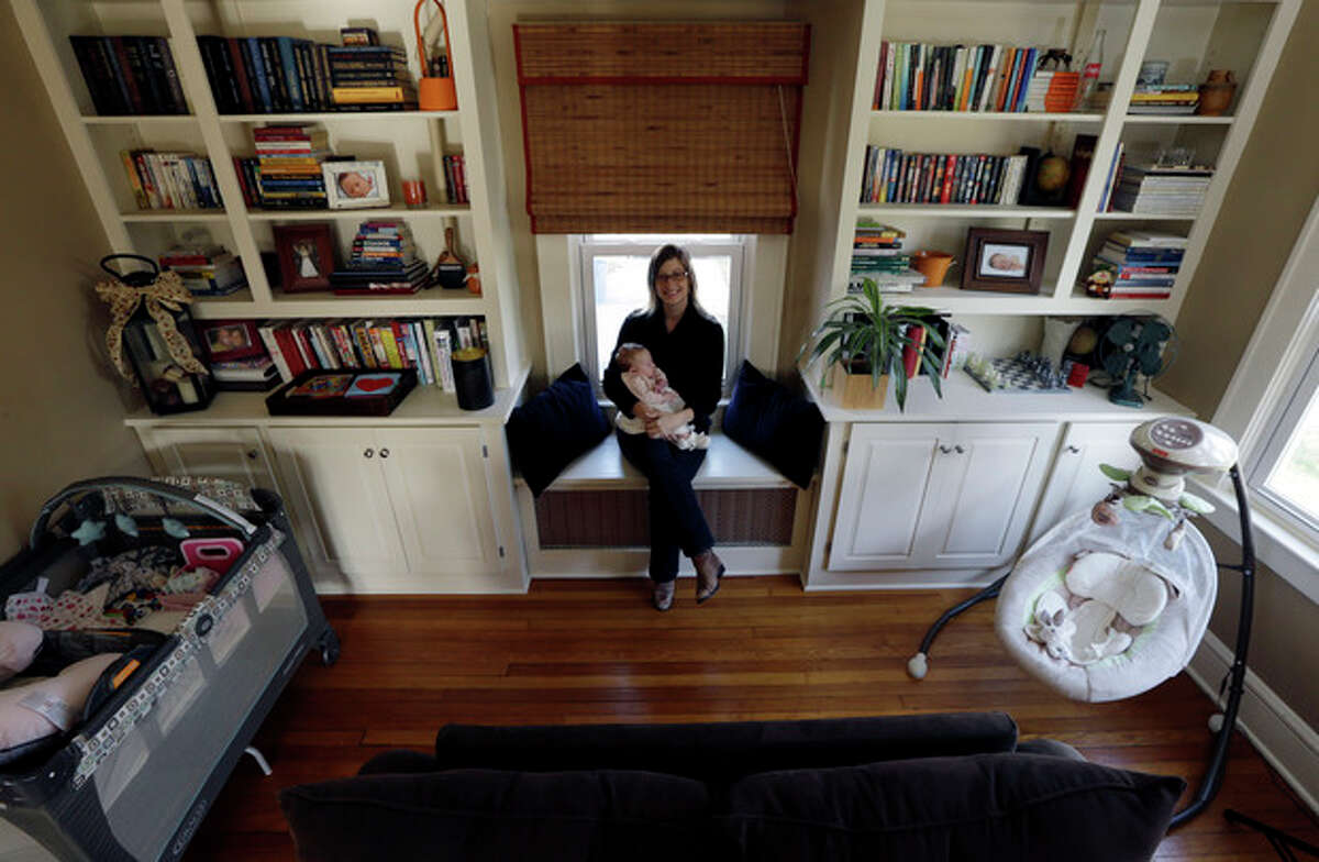 AP Photo/Julio Cortez In this photograph taken Thursday, Nov. 21, Abigail Ernst poses for The Associated Press with her 2-month-old daughter, Lucy, in their Oldwick, N.J. home. Ernst, and her husband, Ken Ernst, conceived Lucy by using only one embryo through in vitro fertilization. With nearly half of all babies born using advanced fertility help being multiple births, doctors are now urging more couples to attempt pregnancy with just a single embryo.