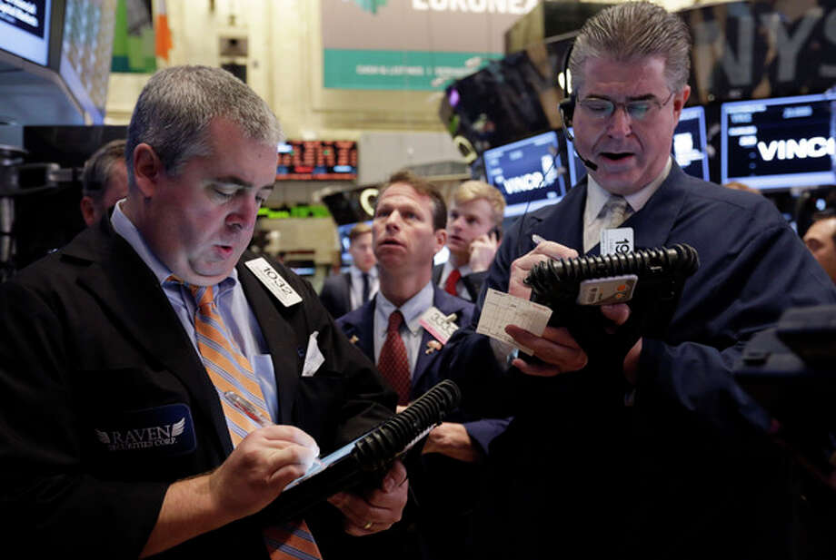 FILE - In this Friday, Nov. 22, 2013, file photo, traders work on the floor of the New York Stock Exchange. (AP Photo/Richard Drew, File) / AP
