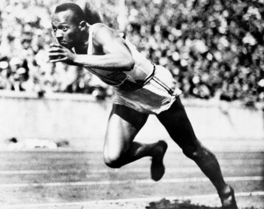 FILE -- In this Aug. 14, 1936, file photo, Jesse Owens competes in one of the heats of the 200-meter run at the 1936 Olympic Games in Berlin. One of the four Olympic gold medals won by Owens at the 1936 Berlin Games is for sale in an online auction that runs from through Dec. 7. (AP Photo/File) / AP