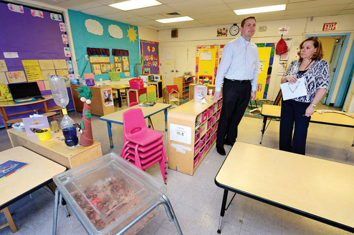 Hour photo / Erik Trautmann Community Development Institute, Inc. (CDI) Program Support Associate Director Mark Elliott and Program Support Specialist Kim Rozzi inspect a Head Start classroom at Nathaniel Ely in preparation for Head Start's reopening Wednesday.
