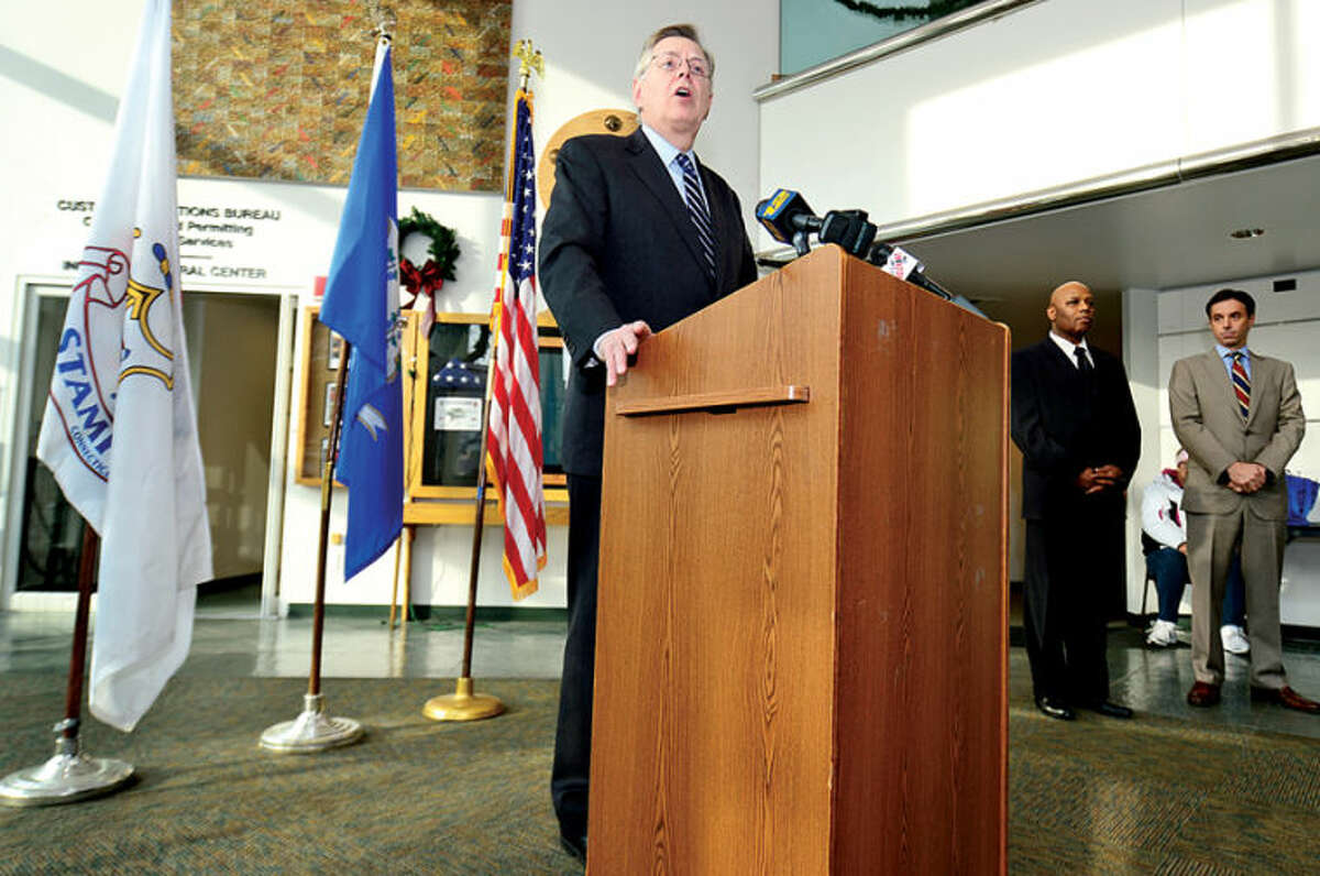 Hour photo / Erik Trautmann Stamford Mayor David Martin announces the appointment of two senior level strategic positions, Michael Pollard for Chief of Staff and Michael Handler for Director of Administration, during a press conference at the Stamford Government Center Tuesday morning.