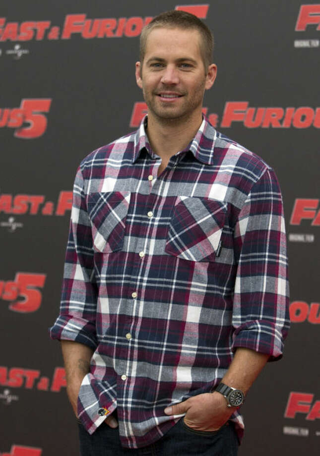 "FILE - In this April 29, 2011 file photo, actor Paul Walker poses during the photo call of the movie ""Fast and Furious 5,"" in Rome. The industrial neighborhood where he died in a car crash is known to attract street racers. Walker and his friend and financial adviser Roger Rodas died in the one-car crash Saturday, Nov. 30, 2013, in the Southern California community of Valencia. (AP Photo/Andrew Medichini, File)"