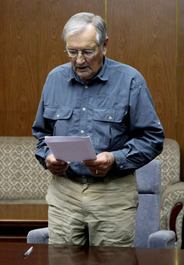 FILE - In this Nov. 9, 2013 file photo released by the Korean Central News Agency (KCNA) and distributed Nov. 30, 2013 by the Korea News Service, U.S. citizen Merrill Newman, 85, reads a document, which North Korean authorities say was an apology that Newman wrote and read in North Korea. Six decades before he went to North Korea as a curious tourist, Newman supervised a group of South Korean guerrillas during the Korean War who were perhaps the most hated and feared fighters in the North, former members of the group say. (AP Photo/KCNA via KNS)
