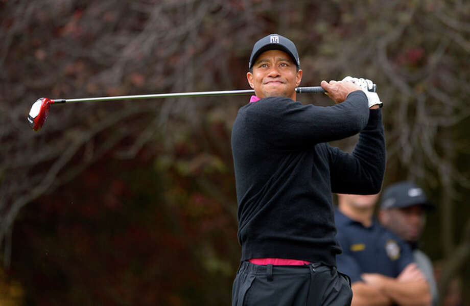Tiger Woods tees off on the second hole during the second round of the Northwestern Mutual World Challenge golf tournament at Sherwood Country Club, Friday, Dec. 6, 2013, in Thousand Oaks, Calif. (AP Photo/Mark J. Terrill) / AP