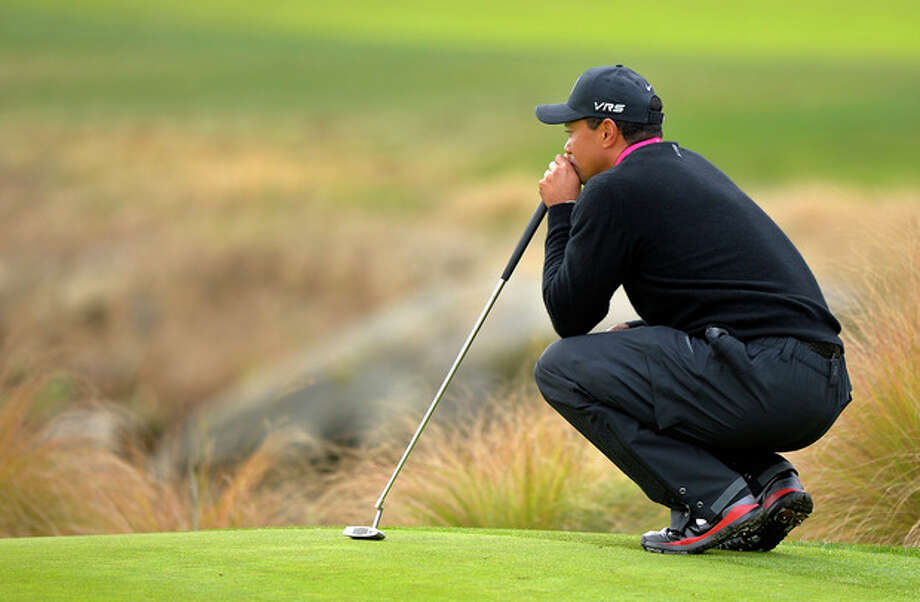 Tiger Woods waits to putt on the second green during the second round of the Northwestern Mutual World Challenge golf tournament at Sherwood Country Club, Friday, Dec. 6, 2013, in Thousand Oaks, Calif. (AP Photo/Mark J. Terrill) / AP