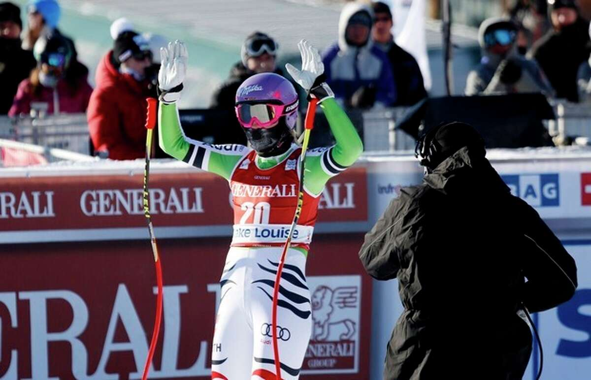 Maria Hoefl-Riesch, of Germany, reacts in the finish area following her run at the women's World Cup downhill ski race in Lake Louise, Alberta, Friday, Dec. 6, 2013. (AP Photo/The Canadian Press, Jeff McIntosh)