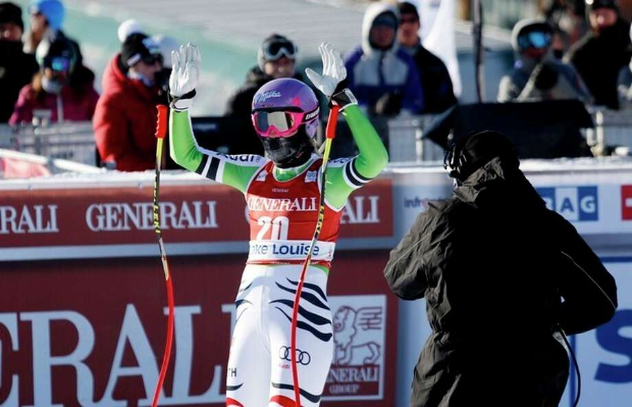 Maria Hoefl-Riesch, of Germany, reacts in the finish area following her run at the women's World Cup downhill ski race in Lake Louise, Alberta, Friday, Dec. 6, 2013. (AP Photo/The Canadian Press, Jeff McIntosh) / The Canadian Press