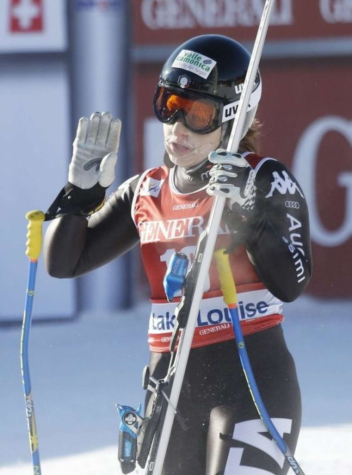 Elena Fanchini, of Italy, reacts in the finish area following her run at the women's World Cup downhill ski race in Lake Louise, Alberta, Friday, Dec. 6, 2013. (AP Photo/The Canadian Press, Jeff McIntosh)